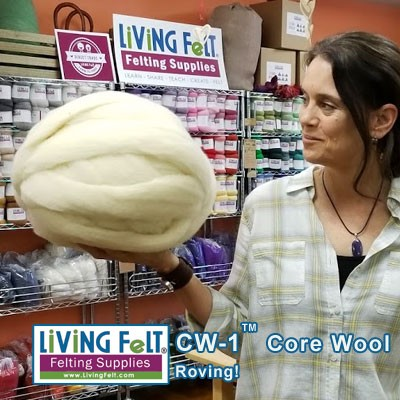 "Marie holding a 1lb ball of roving. We pack it ""loose"" in 8oz bags = easy to pull from!"